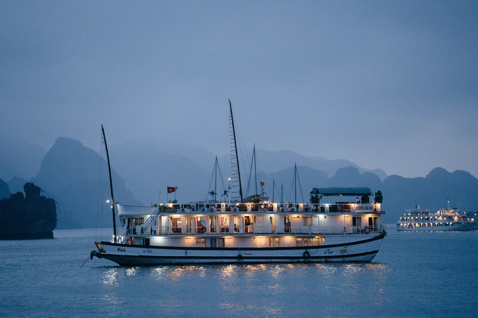 Ha Long Bay illuminated boat at sea