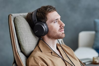 A man relaxing in the comfortable earpads of the MDR-M7M2