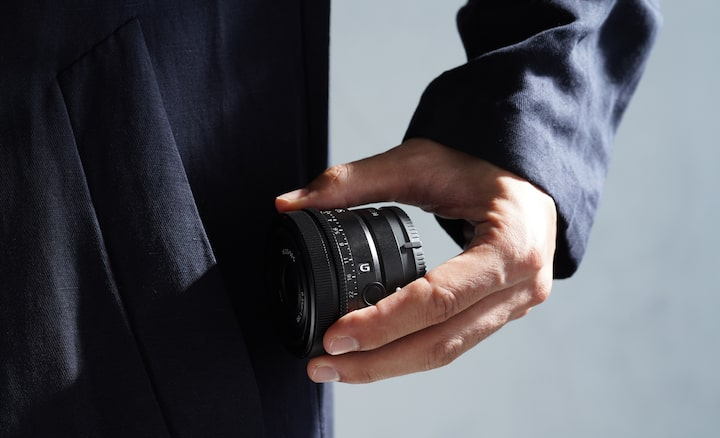 Image of person taking out lens from pocket