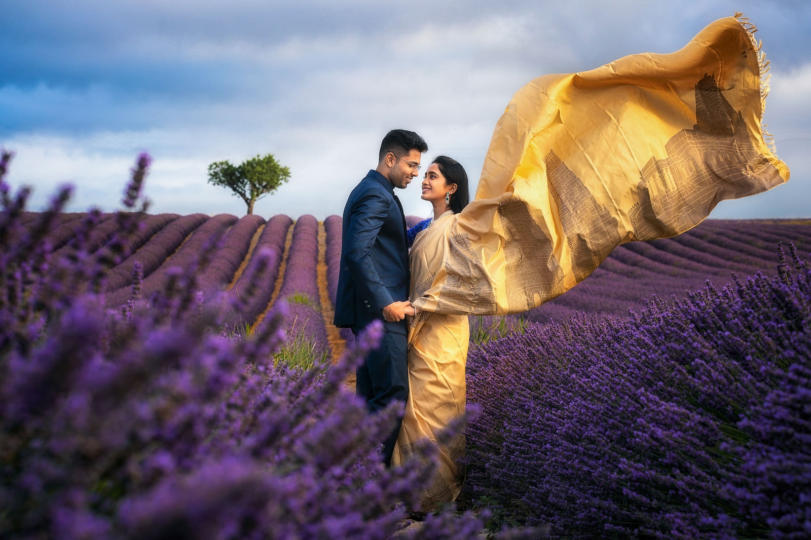 couple standing in lavender fields alpha 7RIII